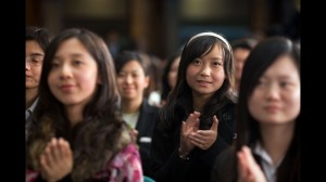 Chinese Students applaud after President Obama's Town Hall in Shanghai on Monday