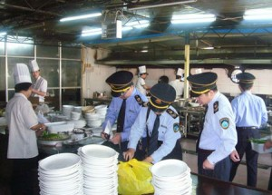 Food safety inspectors reviewing a restaurant in China