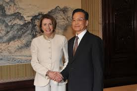 Rep. Nancy Pelosi, shaking hands with former Premier Wen Jiabao