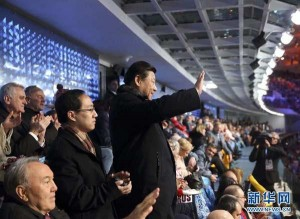 President Xi waving to the Chinese Olympic team during the Sochi Opening Ceremonies