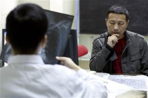 Tang Jitian receiving diagnosis at the hospital AP Photo/Alexander F. Yuan