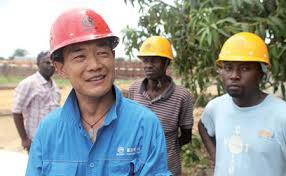 Chinese boss leading a work group in Ghana
