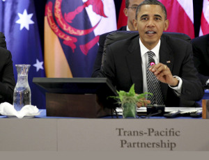 U.S. President Barack Obama (R) speaks as Brunei's Sultan and Prime Minister Hassanal Bolkiah (L) listens during the Trans-Pacific Partnership Leaders meeting at the Hale Koa Hotel during the APEC Summit in Honolulu, Hawaii, November 12, 2011. REUTERS/Larry Downing (UNITED STATES - Tags: POLITICS BUSINESS) - RTR2TXQO