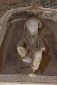 A westernized figurine in one of the earlier caves